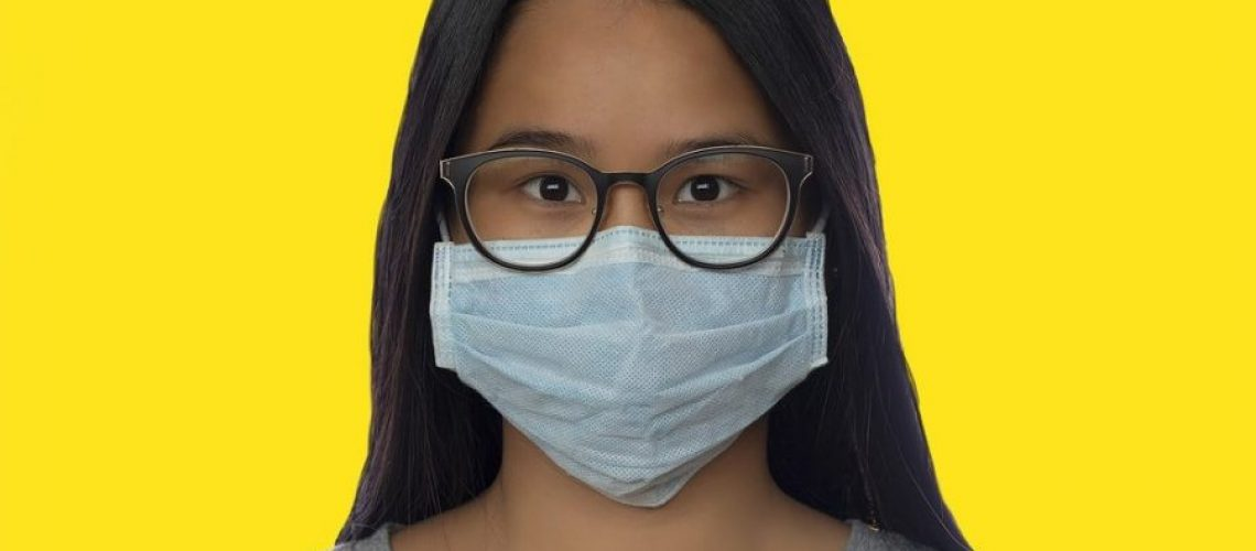 Girl Wearing A Mask With Fogged Glasses